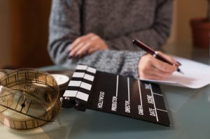 screenwriter with clapperboard